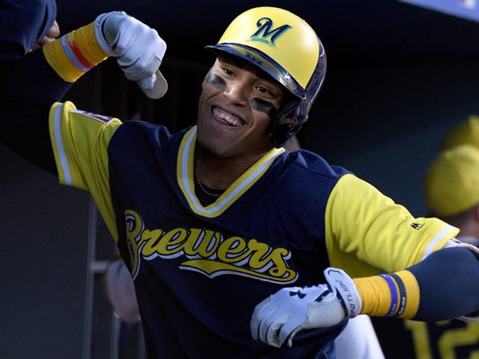Milwaukee Brewers Orlando Arcia celebrates with teammates after hitting a two-run home run during the fifth inning of a baseball game against the Los Angeles Dodgers, Saturday, Aug. 26, 2017, in Los Angeles. (AP Photo/Michael Owen Baker)