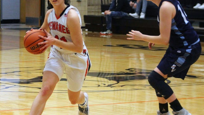 Kewanee's Alyson Shafer serves as the point guard while defended by Bureau Valley's Kyra Stoller (14) on Monday.