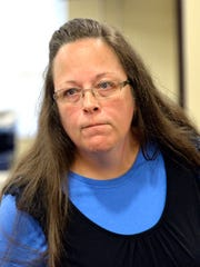 Rowan County Clerk Kim Davis listens to a customer following her office's refusal to issue marriage licenses at the Rowan County Courthouse in Morehead, Ky., Sept. 1.
