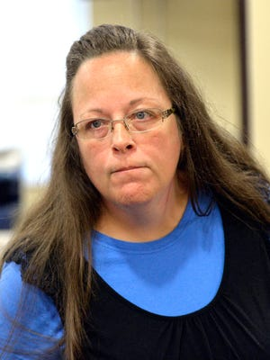 Rowan County Clerk Kim Davis listens to a customer Sept. 1 following her office's refusal to issue marriage licenses at the Rowan County Courthouse in Morehead, Ky. Although her appeal to the U.S. Supreme Court was denied, Davis still refuses to issue marriage licenses.