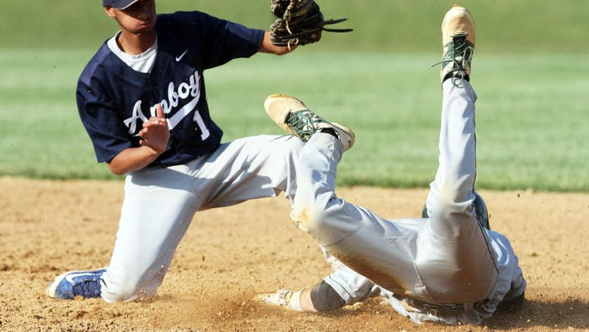 GMC baseball Senior All-Star game held at the North Brunswick Community Park in North Brunswick on Tuesday June 9,2015. South Plainfield High School's # 34 (right)- L.J. Scarpitto dives safely into 2nd base as Perth Amboy Voc Tech's # 1 (left)- Josue Valetin can't get the tag on him in time.