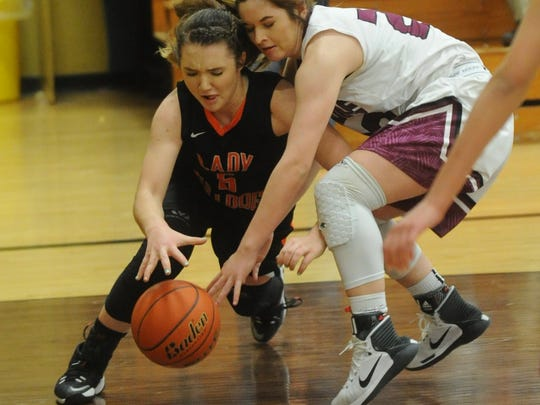 Ira's Madison Peterson, left, battles a Klondike player for a loose ball. Klondike won the Region II-1A quarterfinal playoff game 48-34 on Tuesday, Feb. 21, 2017 in Lamesa.