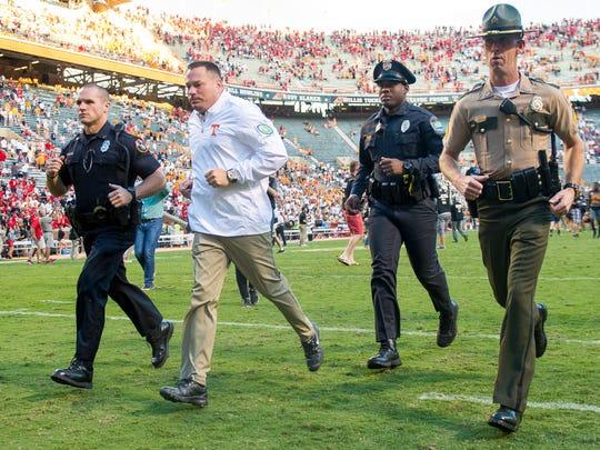 Tennessee Head Coach Butch Jones runs into the locker