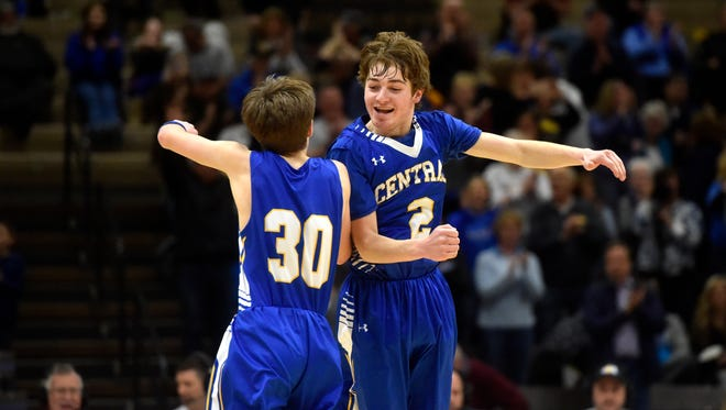 Great Falls Central's Ethan Vincent, right, and Luke Marmon celebrate during last year's Northern C basketball tournament. They are two of eight seniors on a Mustang team coached by Ethan's father, Eric Vincent, that has lost just once this season.