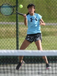 Gracie Pfieffer smacks a forehand in her girls 16 title