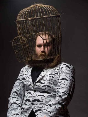 Eric Brooks poses with the bird cage beard design he used during the National Beard & Moustache Championships in Brooklyn Nov. 7.