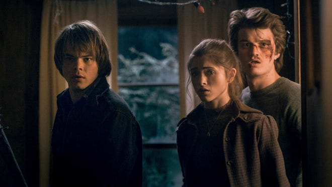 Nashville native Natalia Dyer, center, with Charlie Heaton (left) and Joe Keery (right) on Netflix's 'Stranger Things'