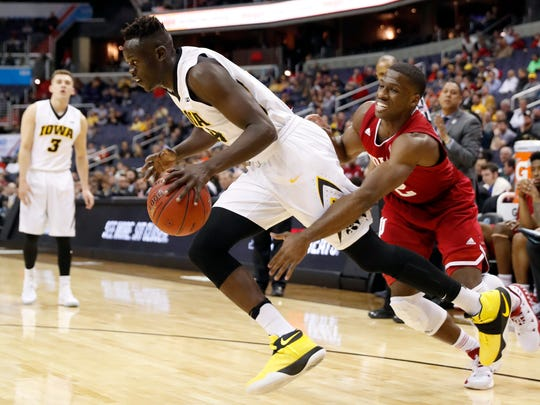 Iowa guard Peter Jok (14) tries to get past Indiana guard Josh Newkirk (2) during the first half in the Big Ten tournament on Thursday in Washington.