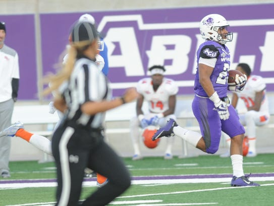 ACU running back Tracy James, right, runs for a 62-yard