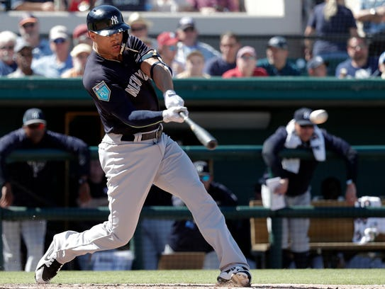 New York Yankees' Giancarlo Stanton hits a double in