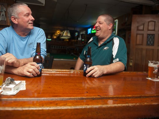 Kevin Miller, left and Errett Vielehr, share a drink and a laugh during an afternoon at the Brewers Pub in Westmont.