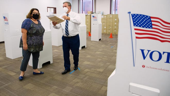 Sangamon County Clerk Don Gray walks temporary seasonal employee Colleen Copp through her role assisting customers in the voting process at the Sangamon County Building Wednesday, Sept. 23, 2020. Early voting starts Thursday, Sept. 24, 2020.