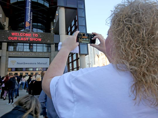 Cami Cenite, of Mineral Point takes a photo of the marquee welcoming visitors to the last show.