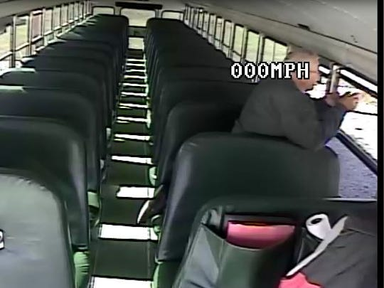 Screenshot from a video of Loudonville bus driver, Glenn Knoble, 69, closing a window near the front of the bus. Knoble didn't do a walkthrough before exiting, and left a 4-year-old sleeping on the bus for four hours.