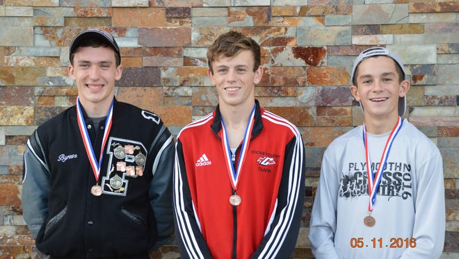 Plymouth's Ethan Byrnes (from left), Canton's Zac Clark and Plymouth's Carter Solomon are all smiles after receiving all-state medals following the Division 1 state finals at MIS in Brooklyn.