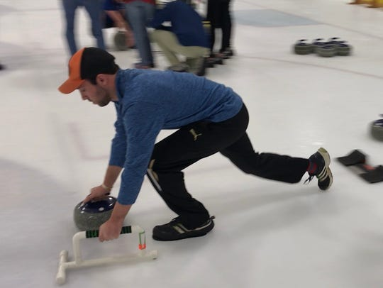 David Going, a first-time curler, is off the block