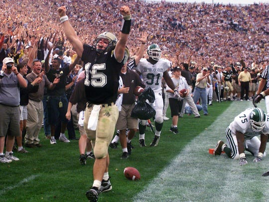 Former Purdue quarterback Drew Brees celebrates his touchdown run against MSU in a 1999 victory over the Spartans. Those were good days for Purdue's football program. The Boilermakers have been a spiral coach since Joe Tiller retired in 2008.