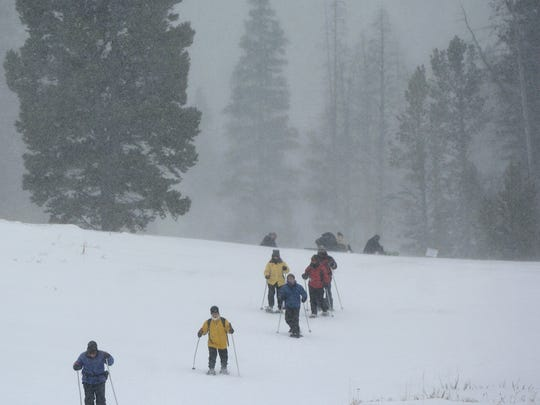 Snowshoers return after a hike during Winter Trails Day. This year's event is set for Feb. 7 at Silver Crest Winter Trails.