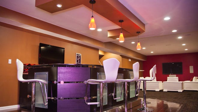 Enjoy a bar area and entertainment area with comfortable lounge seating. By Design Build Pros.