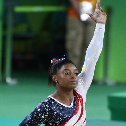 Simone Biles will carry the USA flag at the closing ceremony.