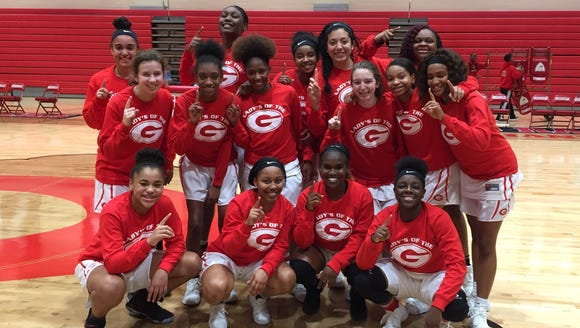 Greenville's girls basketball team enjoys a photo opportunity