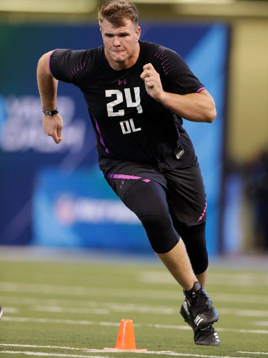 FILE - In this March 2, 2018, file photo, Notre Dame offensive lineman Mike McGlinchey runs a drill at the NFL football scouting combine in Indianapolis. While Mike McGlinchey and Quenton Nelson show their skills to NFL personnel, the Fighting Irish start taking stock on how to replace their standout offensive linemen. (AP Photo/Michael Conroy, File)