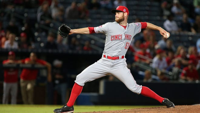 Apr 30, 2015; Atlanta, GA, USA; Cincinnati Reds relief pitcher Tony Cingrani (52) delivers a pitch to an Atlanta Braves batter in the ninth inning of their game at Turner Field. The Reds won 5-1. Mandatory Credit: Jason Getz-USA TODAY Sports