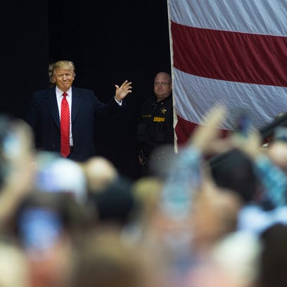 Donald Trump enters the stage at the T. Ed Garrison