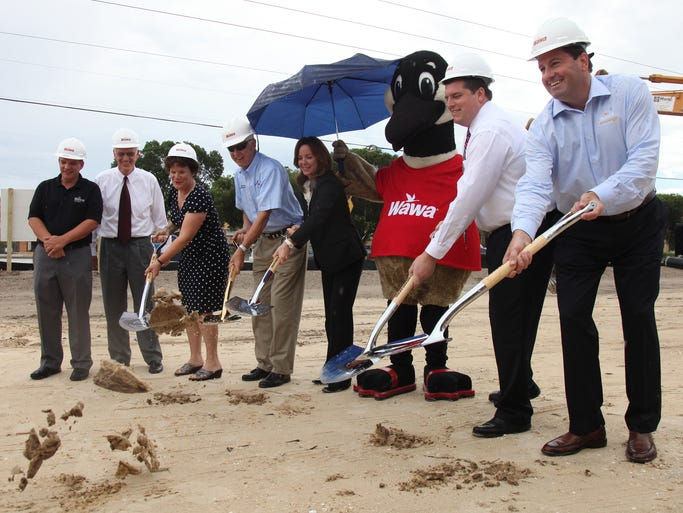 Local dignitaries, along with representatives from Wawa, break ground at their new Fort Myers location near the intersection of Colonial and Fowler on Tuesday.