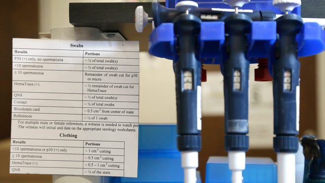 Instructions sit next to pipettes at a station in the biology lab at the Houston Forensic Science Center in April.