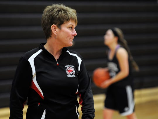 Marshall girls basketball head coach Sal Konkle watches over shooting drills as Marshall practices Wednesday afternoon.