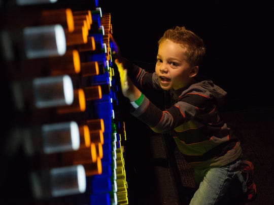 Keagan Goldberg, 5, plays with the Building Blocks of Computer Graphics at the Popnology world premiere in Arizona Science Center in Phoenix, Ariz. on Sunday, Feb. 7, 2016.