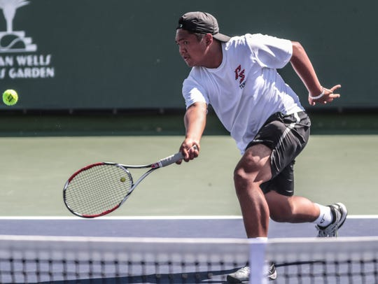 Palm Springs' Michael Cabacungan returns the ball to