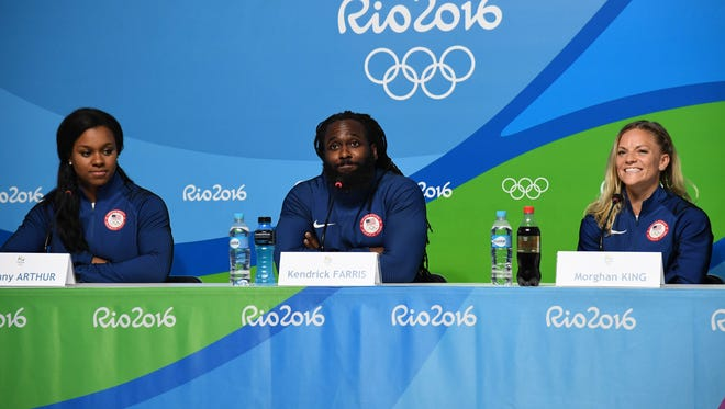 Team USA weightlifting member Kendrick Farris (center) speaks during a press conference at Main Press Center for the Rio 2016 Summer Olympic Games.