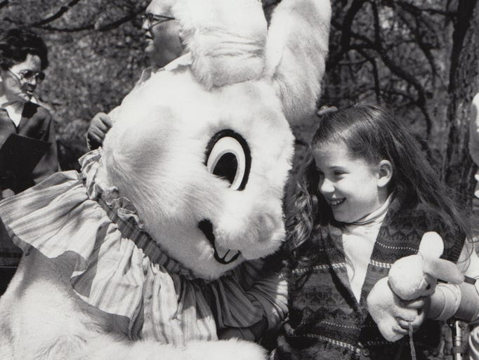 Cara Evans, 8 and the Easter bunny share a laugh after the egg hunt at the Indianapolis Art Museum in 1987.