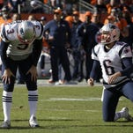 New England Patriots punter Ryan Allen (6) looks on as Patriots kicker Stephen Gostkowski (Madison Central) reacts after missing an extra point following a touchdown by Steven Jackson during the first half the NFL football AFC Championship game between the Denver Broncos.