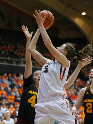 Oregon State's Samantha Siegner, center, shoots over Arizona State's Eliza Normen (cq) in the half of an NCAA college basketball game in Corvallis, Ore., on Monday, Feb. 1, 2016.