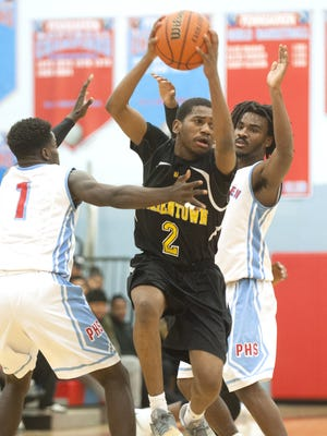 Bordentown senior guard Darnill Brown, pictured here splitting a pair of Pennsauken defenders in Tuesday's game, is averaging nearly 20 points a game for the No. 14 Scotties.