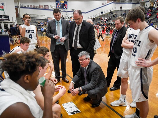 Reitz head coach Michael Adams talks with his team as the Reitz Panthers play the Harrison Warriors at Reitz Thursday, February 8, 2018.
