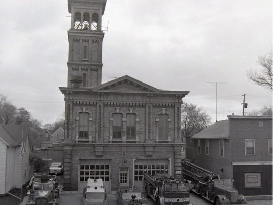 Aetna Fire Company No. 5's team of fire vehicles are parked along Main Street in the 1970s. They included an engine, an ambulance, the Chief's car, a pumper truck and an aerial ladder. Aetna fire station, Main Street in Fond du Lac.