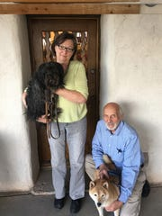 Gallery owner Catherine Smith Brenner and assistant director Don Brenner with their dogs Frankie, left, and Diego