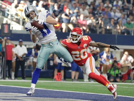 Dallas Cowboys wide receiver Cole Beasley scores a