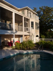 A home rented by Select Vacation Properties in Sanibel has direct acess to the back by and features  a pool.