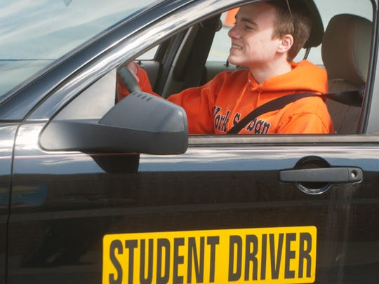 "Putting magnetic ""Student driver"" signs on cars when teens are first learning to drive might make other motorists more patient."