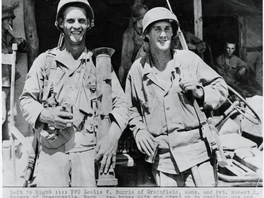 Pvt. Robert E. Meyers (right) and Pvt. First Class Leslie V. Burris enjoy a beer in September 1950 after using their bazookas to knock out three tanks near Yongsan, South Korea. Submitted