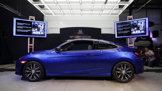 The Honda Civic Coupe production model is shown at Honda's Advanced Design Studio as part of the Los Angeles Auto Show, where it was unveiled Tuesday.