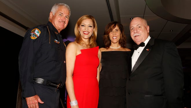 Mike Tobey, Shannon Cake, Debbie Tassone and Brian Edwards enjoyed attending the Military Ball.