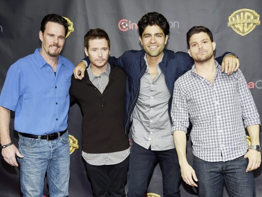 """Left to right, Kevin Dillon, Kevin Connolly, Adrian Grenier and Jerry Ferrara, cast members in the upcoming film """"Entourage,"""" pose together before the Warner Bros. presentation during CinemaCon 2015 at Caesars Palace on Tuesday, April 21, 2015, in Las Vegas."""