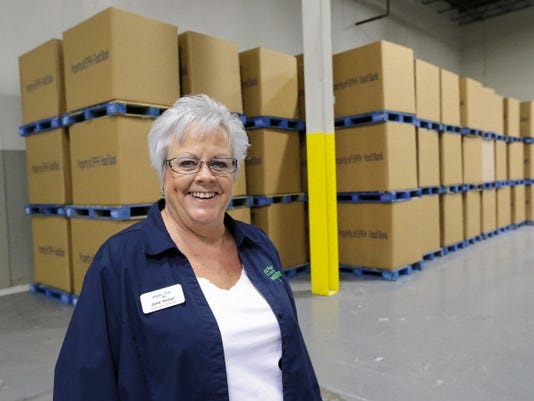 Jane Sinclair, executive director of El Pasoans Fighting Hunger Food Bank, stands in front of the containers that she hopes will be filled by Monday morning after all the food collected by area mail carriers. More than 150 volunteers will begin filling the containers on Saturday afternoon.