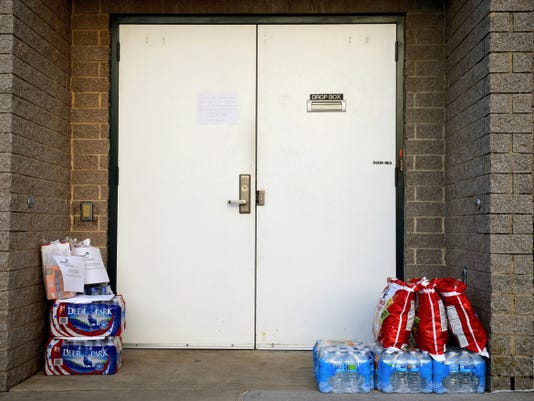 Donated, nonperishable supplies sit outside the Rose Fire Company's door in New Freedom Wednesday. Girl Scouts in the Heart of Pennsylvania Troop 21218 have been collecting bottled drinks and snacks since Monday to donate to emergency personnel in Baltimore.